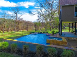 Residential Gunite Pools #027 by Pools Unlimited Inc